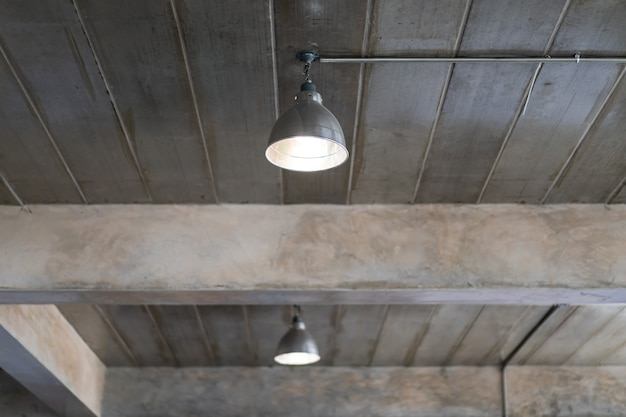 Ceiling lamp in the building that decorated in loft and industrial style close up. Premium Photo
