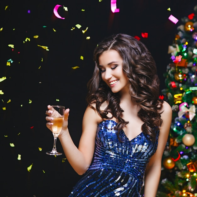 Celebrating woman. holiday people. beautiful girl with perfect makeup holding glass of champagne Premium Photo