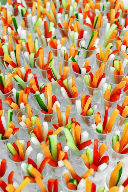 Celebration catering, small portions of colored vegetables Premium Photo