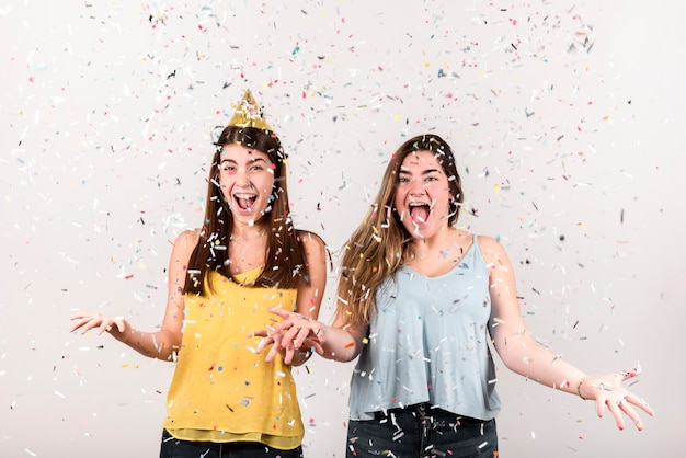 Celebration concept with two delighted girls Free Photo