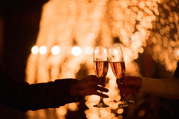 Celebration or party. friends holding glasses of champagne making a toast Premium Photo