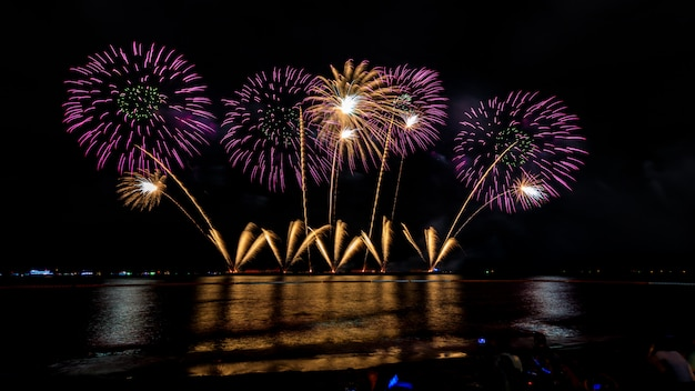 Celebrations firework at night on the sea pattaya city thailand Premium Photo