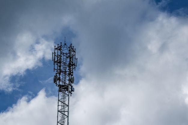 Cellphone tower with clouds in the background Free Photo