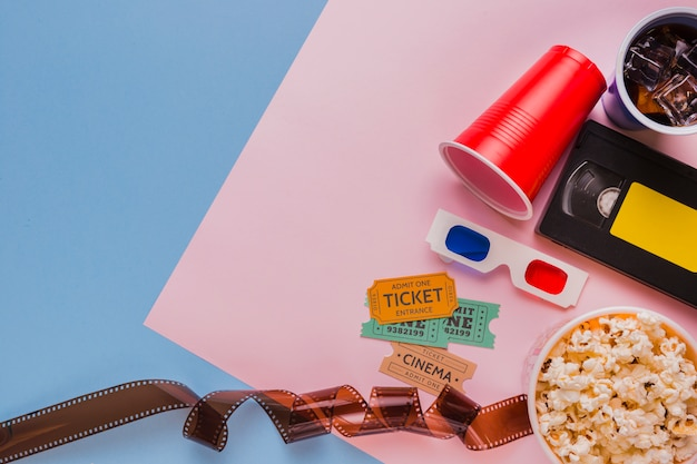 Celluloid with videotape and cinema tickets Free Photo