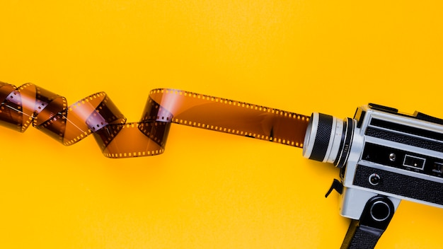Celluloid with vintage videocamera Free Photo