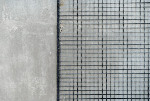 Cement floor background gray wall with steel chain link or wire mesh Premium Photo