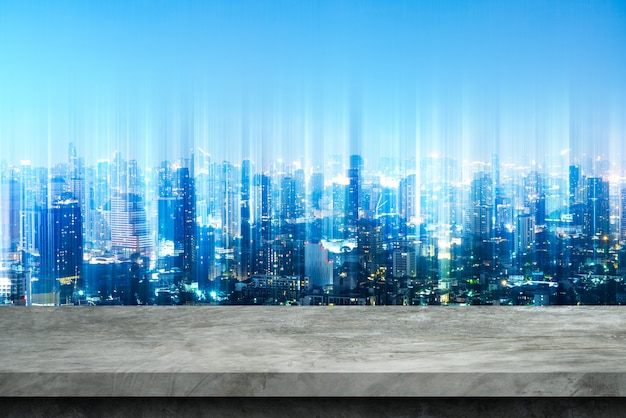 Cement floor and blurry city backgrounds for display products. Premium Photo