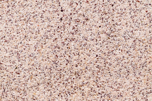 Cement mixed small gravel stone wall texture background of decoration colorful terrazzo floor. Premium Photo