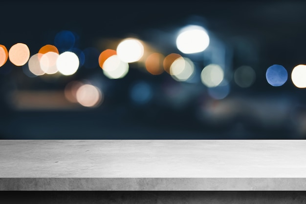 Cement shelf table with blur bokeh  backgrounds, for display products Premium Photo