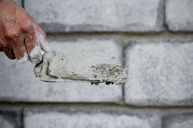 The cement technician is creating the wall. Premium Photo