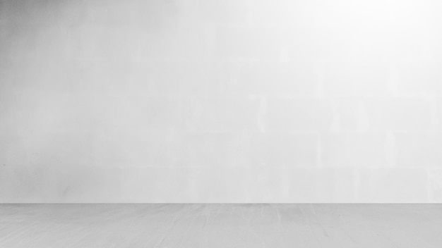Cement wall with floor in the empty room and light for background. Premium Photo
