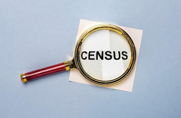Census word through magnifier over blue background. Premium Photo
