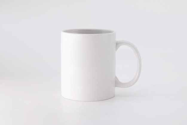 Ceramic mug on white background. blank drink cup for your design. Premium Photo