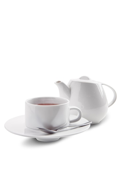 Ceramic tea cup and pot with dilmah tea isolated on white Premium Photo