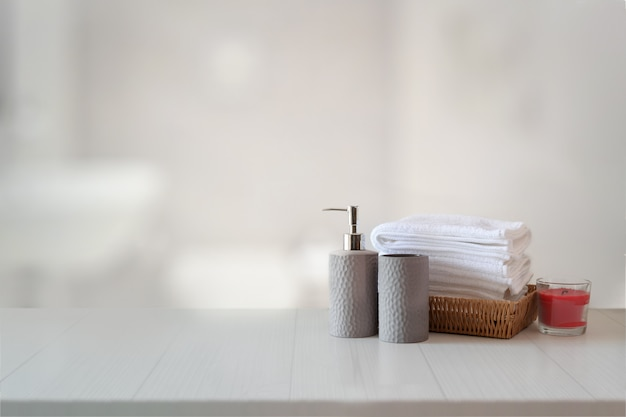 Ceramics shampoo or soap, towels on top marble counter with copy space on bathroom background. Premium Photo