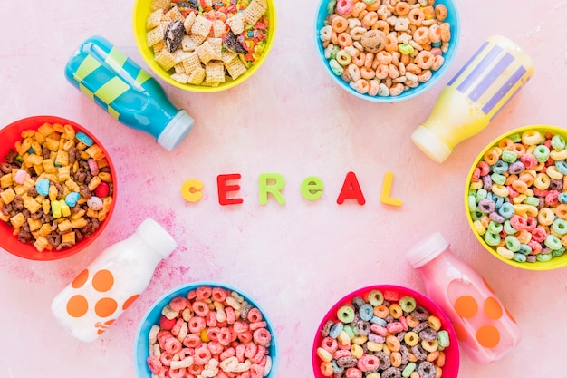 Cereal inscription with bowls on light table Free Photo