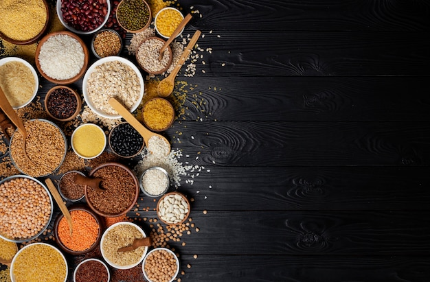 Cereals, grains, seeds and groats black wood Premium Photo