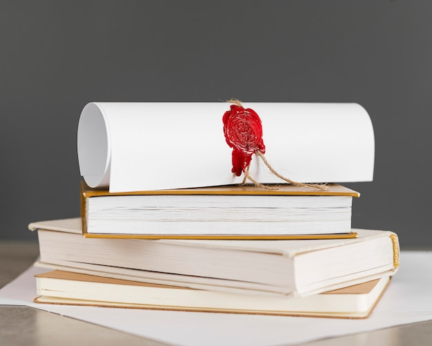 Certificate with wax seal on books Premium Photo