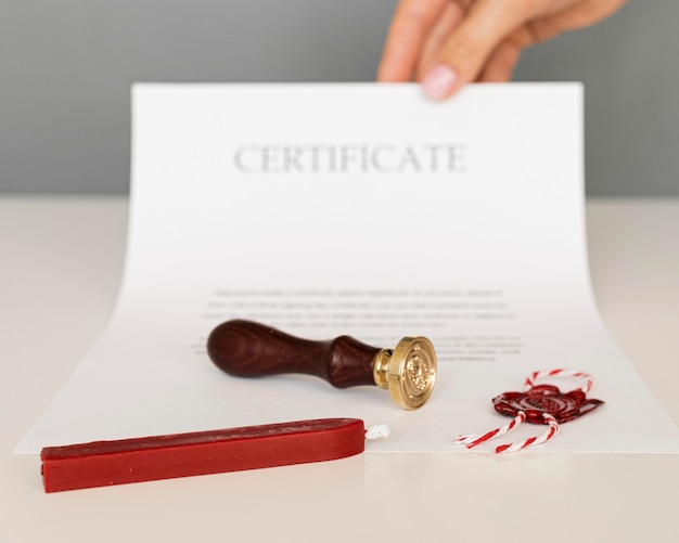 Certificate with wax seal and candle Premium Photo