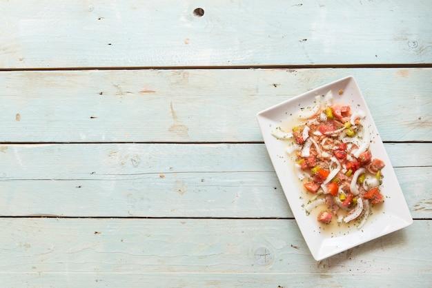 Ceviche with salmon, tomato, onion, lemon Premium Photo