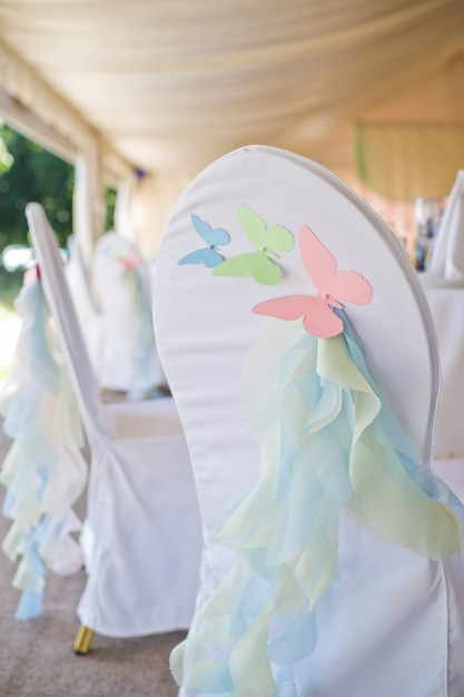 Chair decorated with butterflies made of paper. Premium Photo