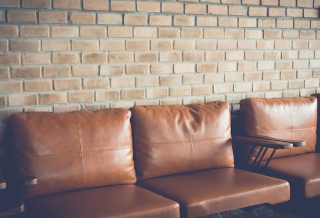 Chair near old brick wall  ( filtered image processed vintage ef Free Photo
