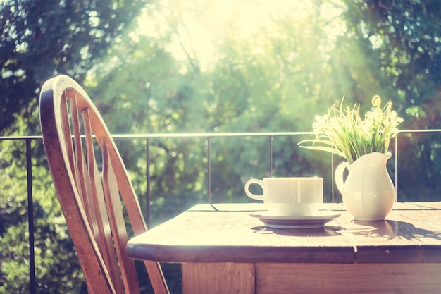 Chair with a wooden table at sunrise Free Photo