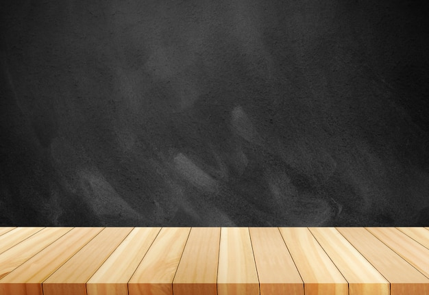 Chalk rubbed out on blackboard.wooden board empty table in front of blurred background. Premium Photo