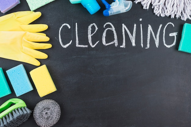 Chalk written cleaning text with various equipments Free Photo