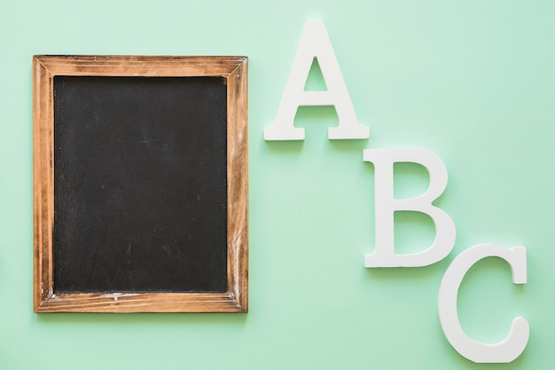 Chalkboard frame with alphabet letters Free Photo