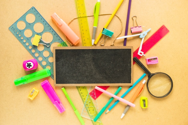 chalkboard lying on stationery photo free download