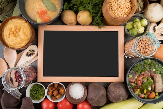 Chalkboard surrounded by soup ingredients Premium Photo