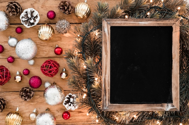 Chalkboard with shiny baubles on table Free Photo