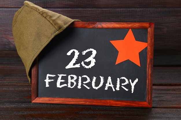Chalkboard with text: february 23. defender of the fatherland day. Premium Photo