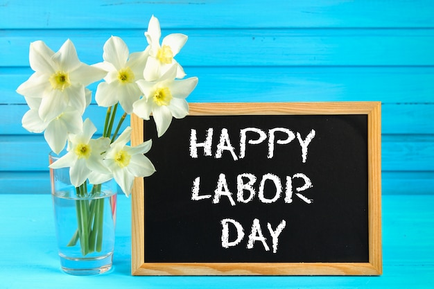 Chalkboard With The Text Happy Labor Day May 1 White Flowers Of