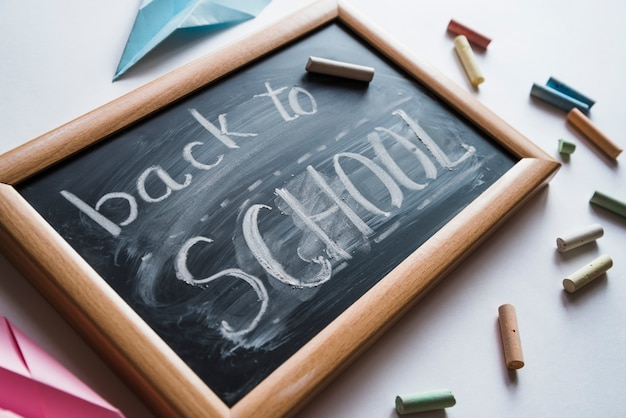 Chalkboard with white back to school sign Free Photo