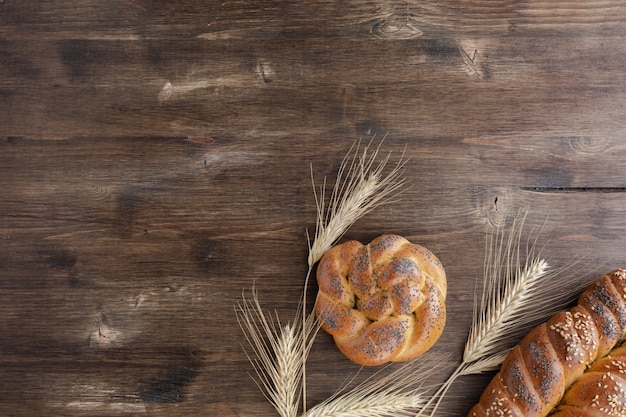 Challah bread on rustic wooden background, top view, copy space Premium Photo