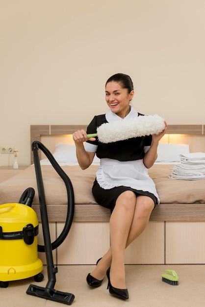 Chambermaid in hotel room Free Photo