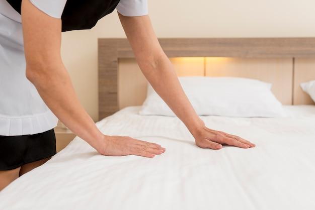 Chambermaid preparing hotel room Free Photo