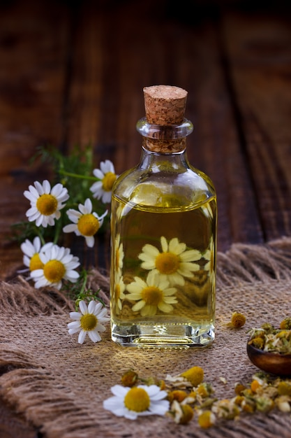 Chamomile oil with dry herbs Premium Photo