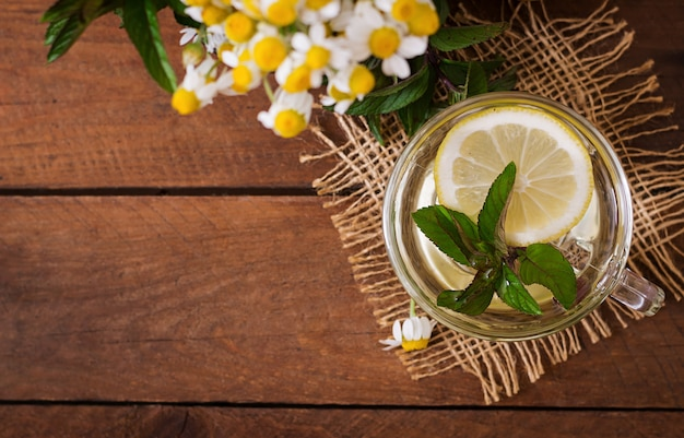 Chamomile tea with lemon and mint. herbal tea. dietary menu. proper nutrition. top view Free Photo