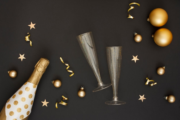 Champagne bottle and decoration with glasses Free Photo