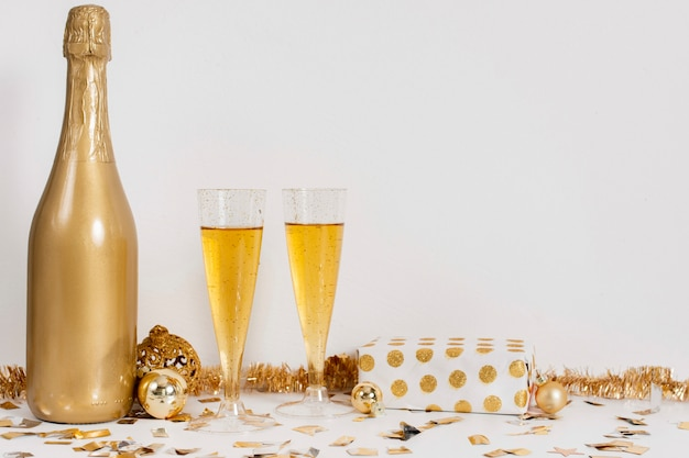 Champagne bottle glasses  and decoration with copy space Free Photo