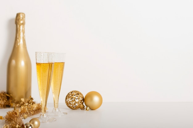 Champagne bottle and glasses with copy space Free Photo