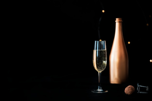 Champagne bottle with glass Free Photo