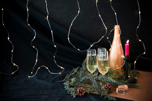 Champagne bottle with green branches Free Photo