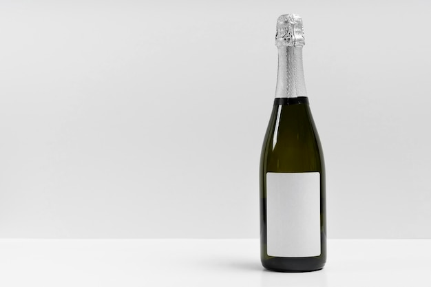 Champagne bottle with white background Free Photo
