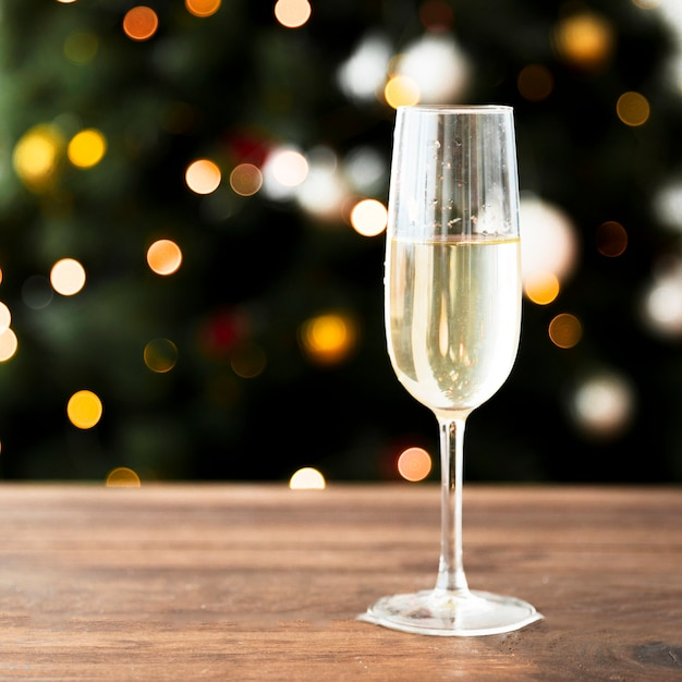 Champagne glass on wooden table Free Photo