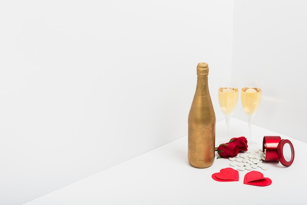 Champagne glasses with small paper hearts Free Photo