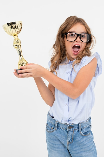 Champion girl holds a winner cup on a white with copy space Premium Photo